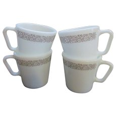 Four Pyrex Corning Woodland Coffee Mugs