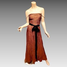 Vtg Kay Unger silk copper fortuny pleat gown with black ribbon bow