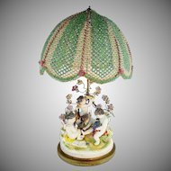 MAGNIFICENT Porcelain Putti Lamp &  Grandest Beaded Shade ~ Four Playful Putti & Sweet Porcelain Flowers~ Style of Aelteste Volkstedter Porzellanmanufaktur Thuringia, Germany…and Bears it Mark.