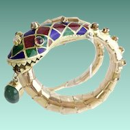 ESTATE Vintage Enamel Snake Bracelet with Emerald, Rubies, and Diamonds ~The Snake's Head has Green, Cobalt Blue and Rusty Red Enamel Diamond Shapes with Ruby Eyes with Diamonds Down the Head ~The Snake has a Big Oval Emerald Dangling from the Mouth.