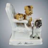 """Antique PUGS  in a Chair  """"A  Porcelain Masterpiece """""""