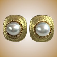 14KARAT yellow gold Cultured Mabé pearl earrings with hammer finish ~ Pearls are bezel set in the center of cushion shaped hammer finished mounts.