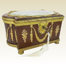 Antique French Empire Casket Hinged Box ~ Exquisite  Dark Wood Casket Circled in Gilt Ormolu Swags and Mounted in Ornate Gilt Ormolu w Fancy Footed Base ~ Thick Oval Beveled Glass Top