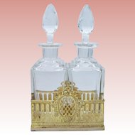 Antique French Baccarat Crystal Gilt Ormolu Cave A Liqueur Decanter Tantalus ~ Twin Crystal Decanters with Large Cut Stoppers ~  Resting in Beautiful Gilt Ormolu Holder ~ Baccarat Quality and Style