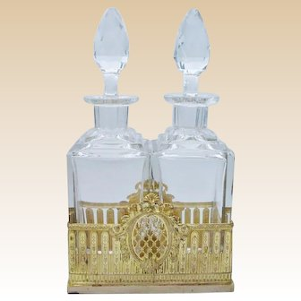 Antique French Crystal Gilt Ormolu Cave A Liqueur Decanter Tantalus ~ Twin Crystal Decanters with Large Cut Stoppers ~  Resting in Beautiful Gilt Ormolu Holder ~ Baccarat Quality and Style