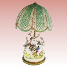 MAGNIFICENT Porcelain Putti Lamp & Grandest Beaded Shade ~ Four Playful Putti & Sweet Porcelain Flowers ~ Style of Aelteste Volkstedter Porzellanmanufaktur Thuringia, Germany and Bears it Mark.