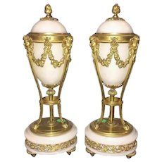 Antique French Marble and Bronze Urns. Elegant White Marble and Beautiful Gilt Bronze Urns with Reversible Caps Converting to Candlesticks.