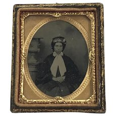 Ambrotype Portrait of Woman Wearing Bonnet with Large Bow seated by Urn
