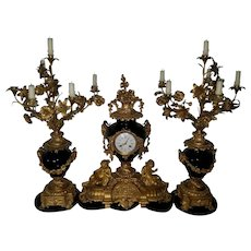 A 19th Century French Ormolu-Mounted Sevres Style Porcelain Clock Garniture