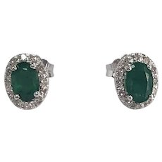 Oval Emerald and Diamond Halo Stud Earrings in 14K White Gold