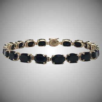 Oval Blue Sapphire Line Bracelet in 10K Yellow Gold