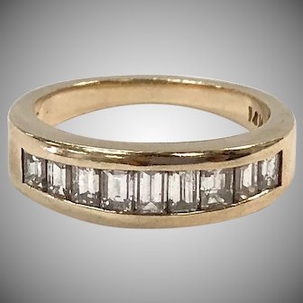 Diamond  Channel Set band with 9 Baguettes set in 14K  yellow gold