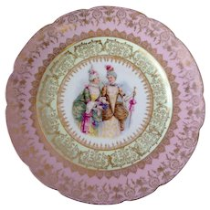 GFB & Co Porcelain Plate with painting of fashionable ladies, pink rim, and gold outline