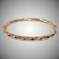 10K Yellow Gold Hinged Bangle Bracelet with Twisting Rope Texture and Safety Clasp