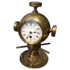 A brass Maritime clock.