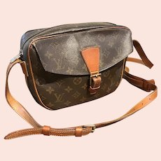 Louis Vuitton shoulder purse.