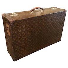 A Louis Vuitton vintage suitcase.