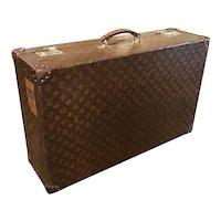 A Vintage Louis Vuitton suitcase.