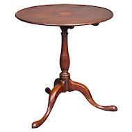 A tilt top Wine Table / occasional table in Mahogany.