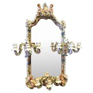 A magnificent wall mirror in the manner of Dresden or Meissen, certainly from the Sitzendorf region of Germany.
