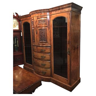 An English Breakfront Olive wood Armoire.