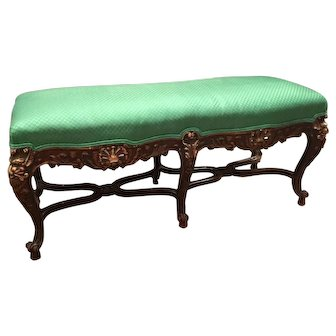 A Gothic Revival 6 leg bench in Walnut.