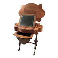 An English 19th Century Writing and Sewing Table.