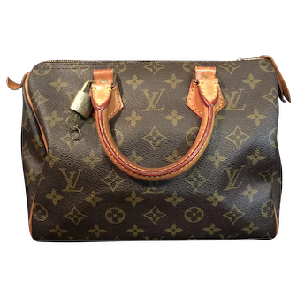 "A Vintage Louis Vuitton ""Speedy 25"" Bag"