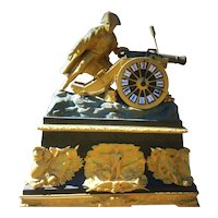 French patinated fire gilt bronze clock of Napoleon firing a cannon