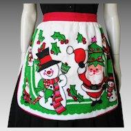Vintage 1960s Holiday Apron Bright Santa and Snowman Print