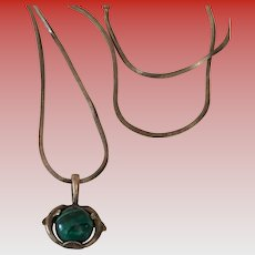 Pendant - Two Sterling Dolphins surrounding a round Malachite stone on a Sterling chain