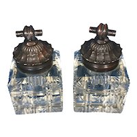 A Pair Of Cut Glass Inkwells with Bronze Lids.