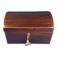 Sheraton mahogany domed top box.