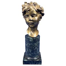19th Century Gilt Bronze Bust Of A Boy.