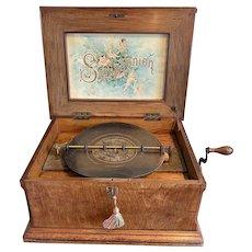 Walnut Music Box With original book of discs.