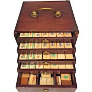 Vintage Bone Tile Mahjong Set  Great Wood Dovetailed Case with Drawers Brass Mounts Brass Dragon Image on Case Front Door Unknown Maker