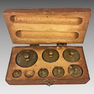 7 Larger Antique Brass Weights 1 Missing in Wood Case