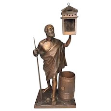Antique Bronze Inkwell Full Figural Man Holding Lantern and Oaken Barrel  Base Relief of Flowers Missing Inkwell Liner Shannon Manufacturing Co., Philadelphia, PA