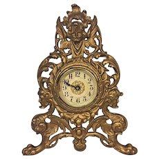 Antique Gilt Metal Shelf Clock Gargoyle Base w/ Winged Cherub Crest Time Only Runs