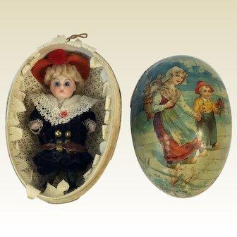 All Bisque German Boy Mignonette Doll in Cardboard Egg. Original Costume. Circa 1900