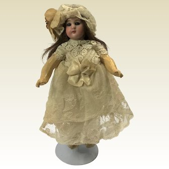 """Antique Walking Action Doll. German, Bisque, Composite. Original Clothes. Indistinctly marked. C.1890. 9.5"""""""