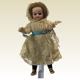Beautiful Bisque and Paper Mache Mignonette Doll. Stunning Costume.