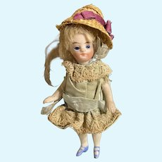 French All Bisque Mademoiselle Mignonette with blue socks & the egg box
