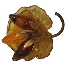 Amber-colored Lucite and Brass Floral Pin