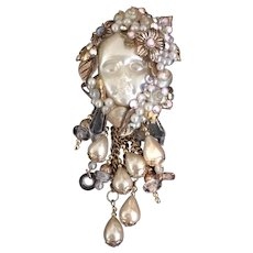 Baby Doll Face Dripping with Faux Pearls Pin