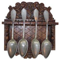 Four Pewter Spoons in Wood Spoon Rack