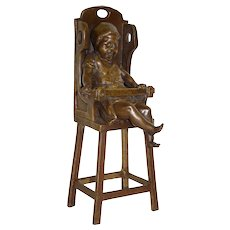 Bronze Crying Child in Highchair