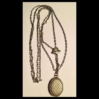 Antique Victorian sterling locket and chain and slide