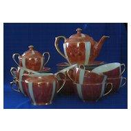 Schaller Orange Luster And White Luncheon Tea Set