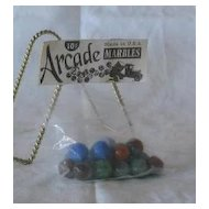 "Sealed Package Of ""Arcade"" Marbles"